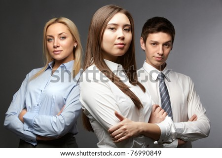 Portrait of three determined businesspeople looking at camera - stock photo