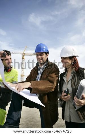 Portrait of three entrepreneurs on a construction site - stock photo