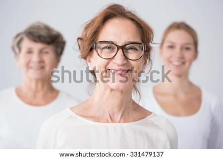 Portrait of three generations of female family - stock photo