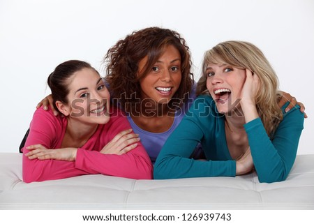Portrait of three happy girlfriends - stock photo