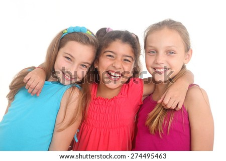 portrait of three happy girls on a white background - stock photo
