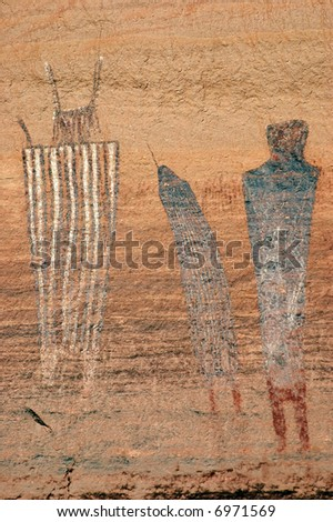 portrait of three pictograph figures in cayonlands national park - stock photo