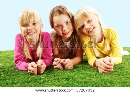 Portrait of three restful girls - stock photo