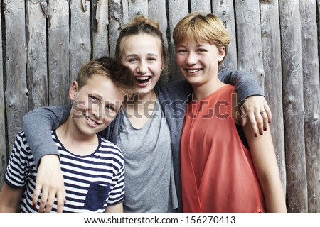 Portrait of three siblings - stock photo