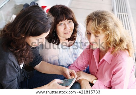 Portrait of three smiling 40 years old women - stock photo