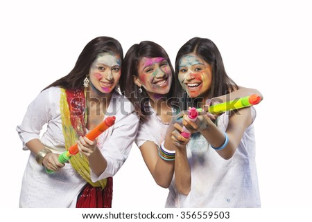 Portrait of three women playing holi - stock photo