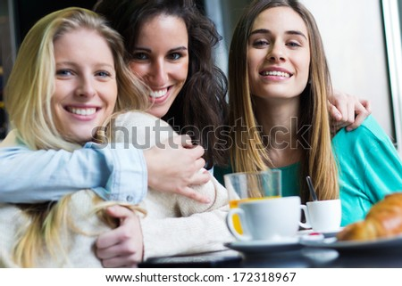 Portrait of Three young women having coffee break - stock photo