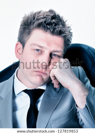 Portrait of  tired businessman at the office - stock photo