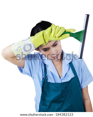 Portrait of tired maid holding cleaning tool. isolated on white - stock photo