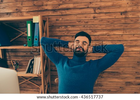 Portrait of tired young man having break and sleeping - stock photo