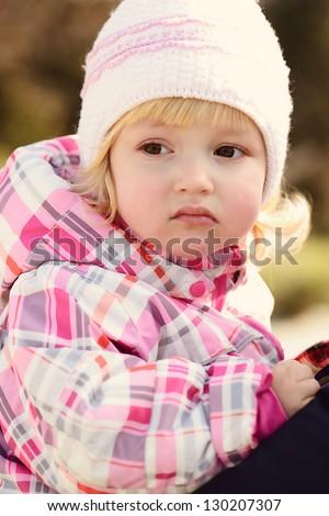 portrait  of toddler girl wearing win?er clothing - stock photo