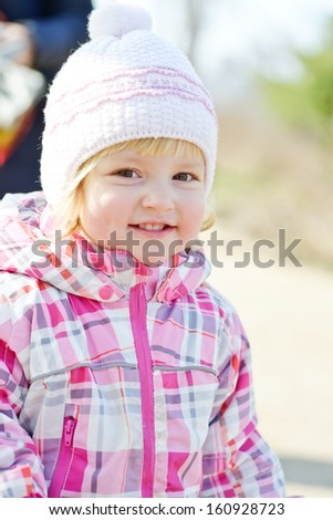 portrait of toddler girl wearing winter clothing - stock photo