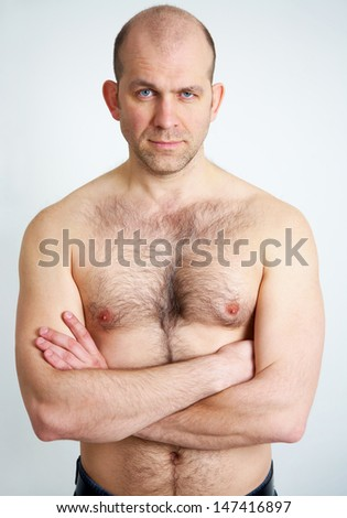 Portrait of topless handsome man on white background - stock photo