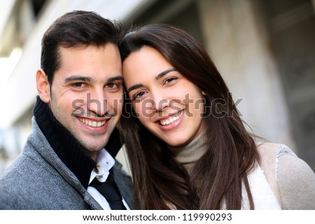 Portrait of trendy couple in town - stock photo