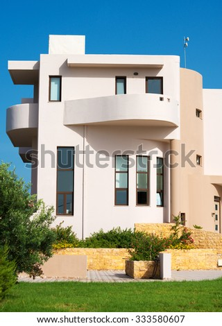 Portrait of tropical apartment building with balcony. - stock photo