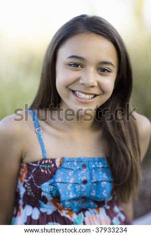Portrait Of Tween Girl Smiling To Camera - stock photo