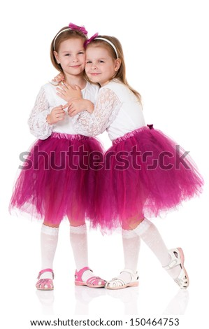 Portrait of twin girls, isolated on white background - stock photo