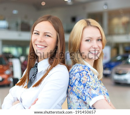 portrait of two attractive caucasian smiling business women  - stock photo