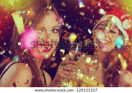 Portrait of two beautiful girls on the New Year's Eve - stock photo
