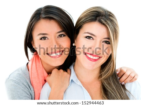 Portrait of two beautiful sisters smiling - isolated over white  - stock photo