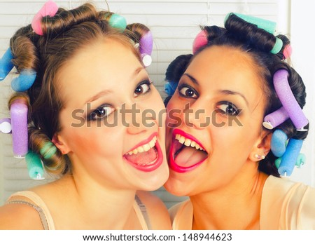 Portrait of two beautiful young housewives having fun. - stock photo