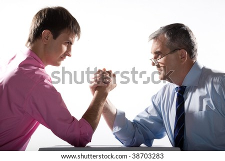 Portrait of two businessmen fighting over white background - stock photo