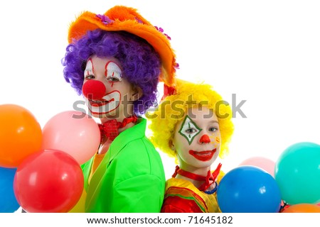 portrait of two children dressed as colorful funny clowns with balloons over white background - stock photo
