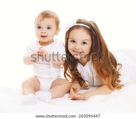 Portrait of two children, older and younger sister - stock photo