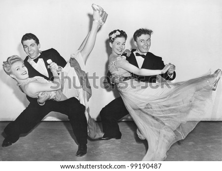 Portrait of two couples dancing - stock photo