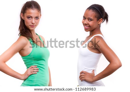 portrait of two different nationalities teenage girls friends - isolated on white background - stock photo