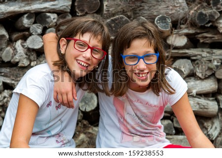 Portrait of two disabled sisters together outdoors. - stock photo