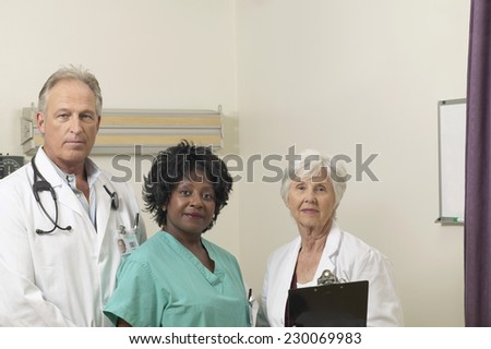 Portrait of two doctors and a nurse posing for the camera - stock photo