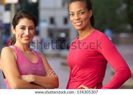 Portrait Of Two Female Runners On Urban Street - stock photo