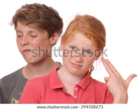 Portrait of two funny grimacing teenagers - stock photo