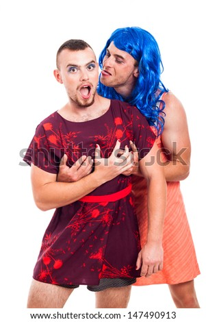 Portrait of two funny transvestites having fun, isolated on white background - stock photo