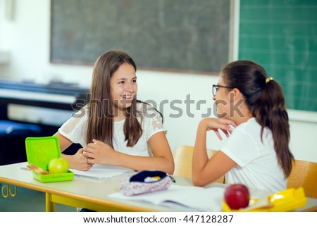 Portrait of two girls in the lunch break at the school, selective focus - stock photo