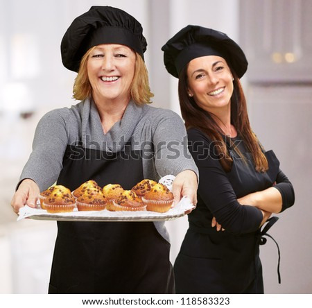 Portrait Of Two Happy Chef, Indoor - stock photo