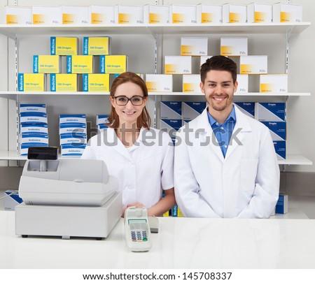 Portrait Of Two Happy Pharmacist In Pharmacy - stock photo