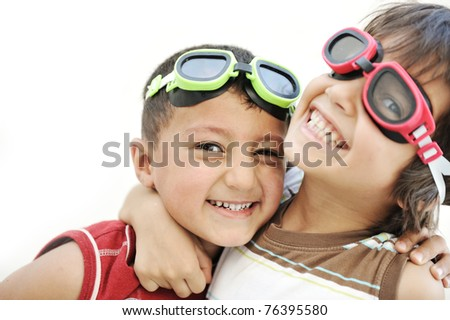 Portrait of two little children friends making funny faces and playing together - stock photo