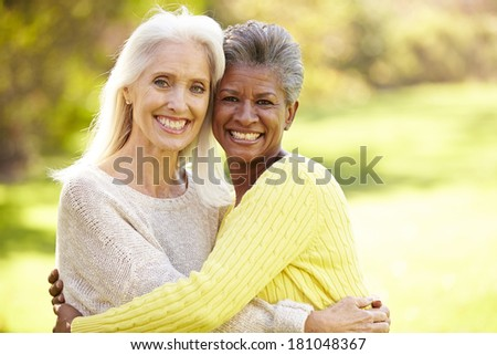 Portrait Of Two Mature Female Friends Hugging - stock photo