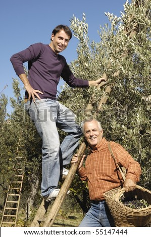 Portrait of two men during harvest - stock photo