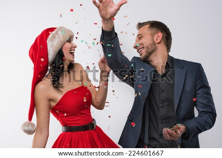Portrait of two people man and woman in love celebrating new year eve or christmas party - stock photo