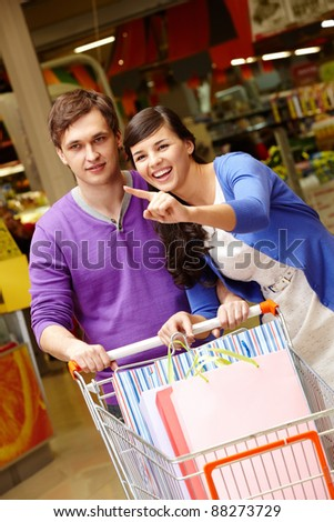 Portrait of two shopaholics during shopping in the mall - stock photo