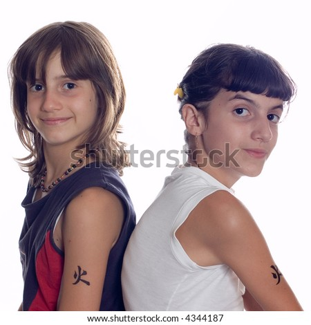 Portrait of two sisters posing on white backgrounds - stock photo