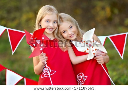 portrait of two sisters with decor style Valentine's Day - stock photo