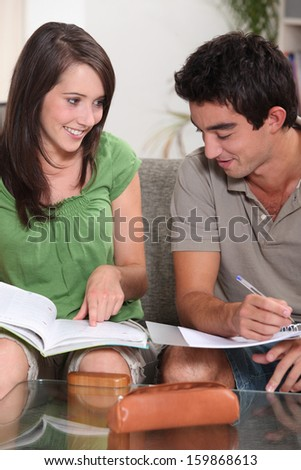 portrait of two teenagers studying - stock photo