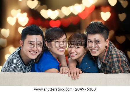Portrait of two Vietnamese couples having double date - stock photo