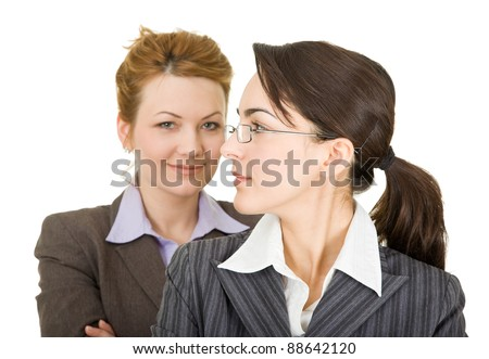 portrait of two women in office clothes on a white background - stock photo