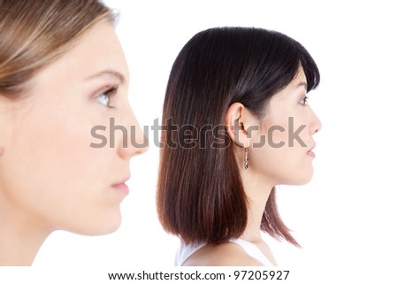 Portrait of two women isolated on white background. - stock photo