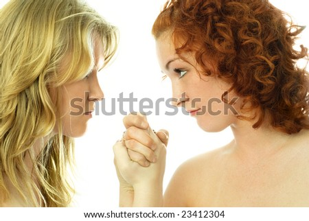portrait of two young arguing women isolated against white background - stock photo